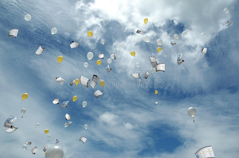 Sending Data to the Cloud. Cloud computing. Concept of sending data to the cloud, with gold and silver balloons carrying the data away