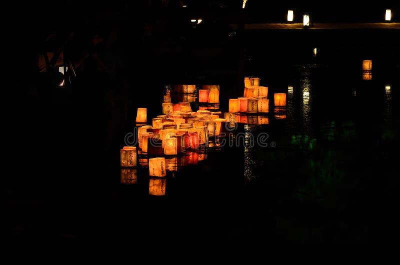 Sending down paper lanterns, Kyoto Japan. royalty free stock image