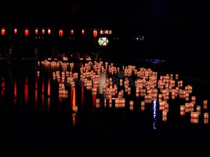 Sending down paper lanterns in the the river of Arashiyama, Kyoto Japan. royalty free stock image