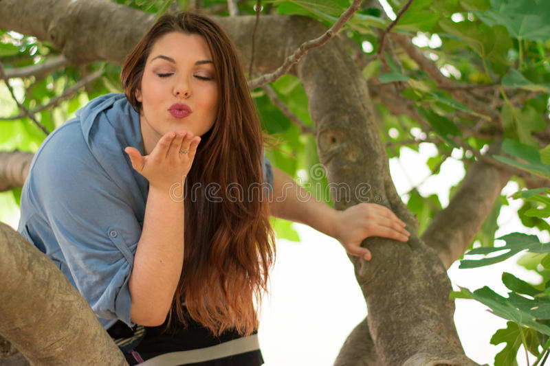 Sending a kiss from the tree stock photos