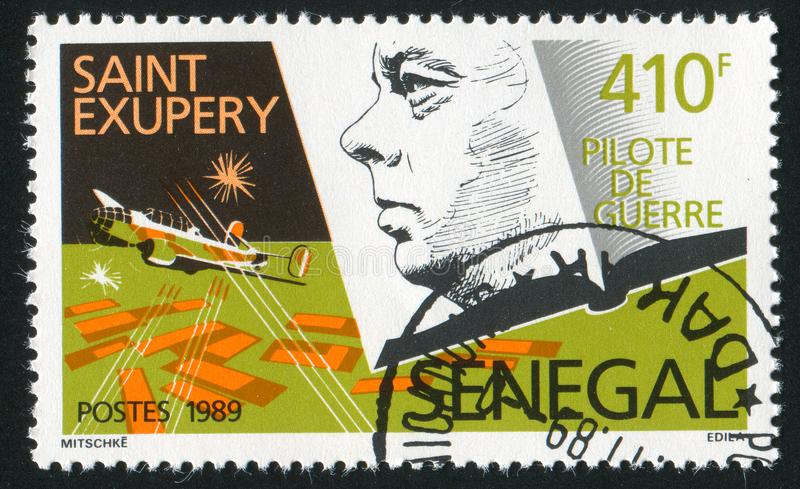 Antoine de Saint-Exupery. SENEGAL - CIRCA 1989: stamp printed by Senegal, shows Antoine de Saint-Exupery, Bomber pilot, circa 1989 royalty free stock photo