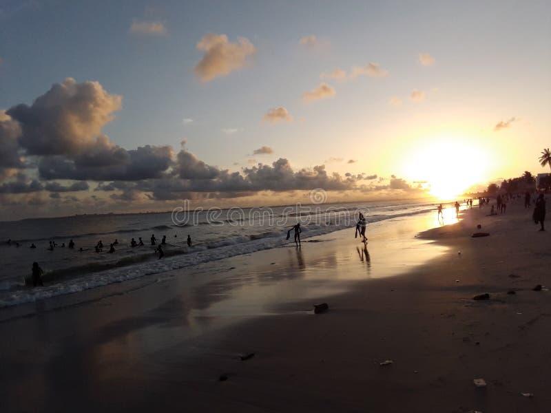 Sunset in Africa. Senegal dakar children child beach playing swiming sundown stock images