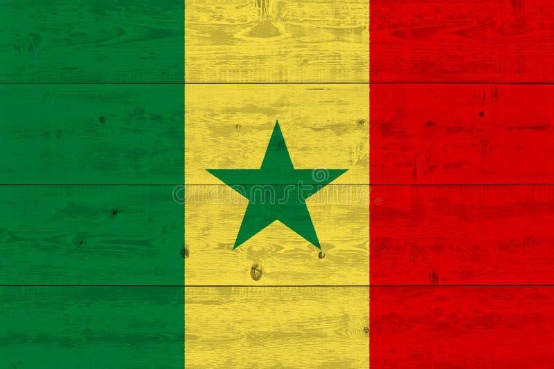 Senegal-Flagge gemalt auf alter hölzerner Planke stockfoto