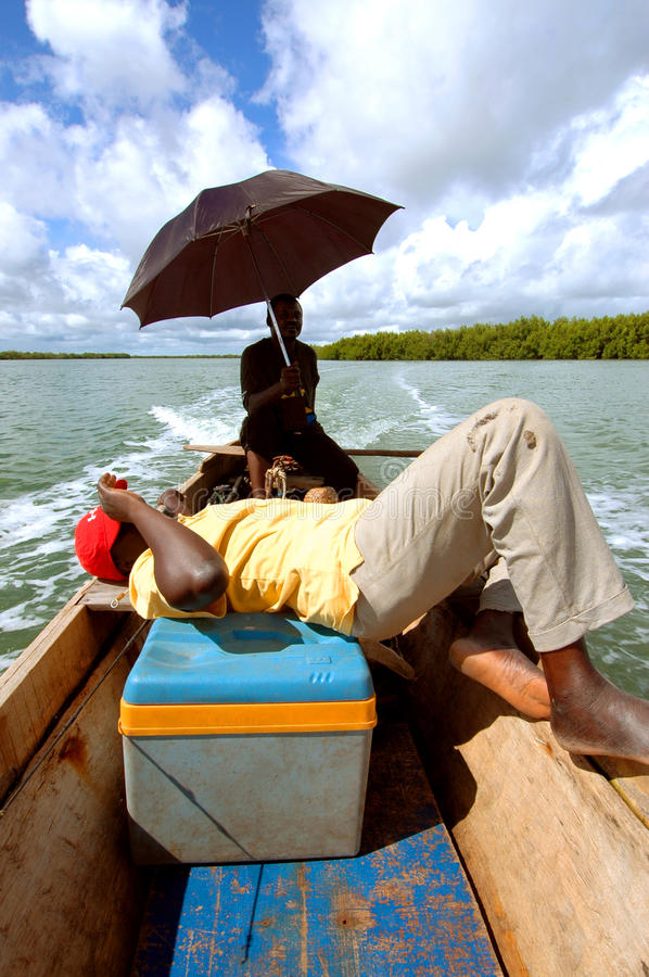 SENEGAL - JUNE 12: Two boat men taking a relax time on June 12, royalty free stock photo