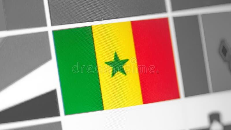 Senegal-Staatsflagge des Landes Senegal-Flagge auf der Anzeige, ein digitaler Wässerungseffekt lizenzfreies stockfoto