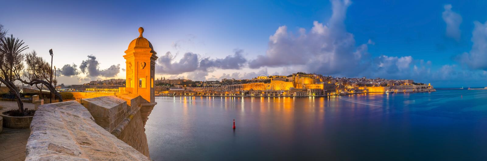 Senglea, Malta - Panoramic skyline view at the watch tower at Fort Saint Michael, Gardjola Gardens. With beautiful sky and clouds at blue hour royalty free stock photos