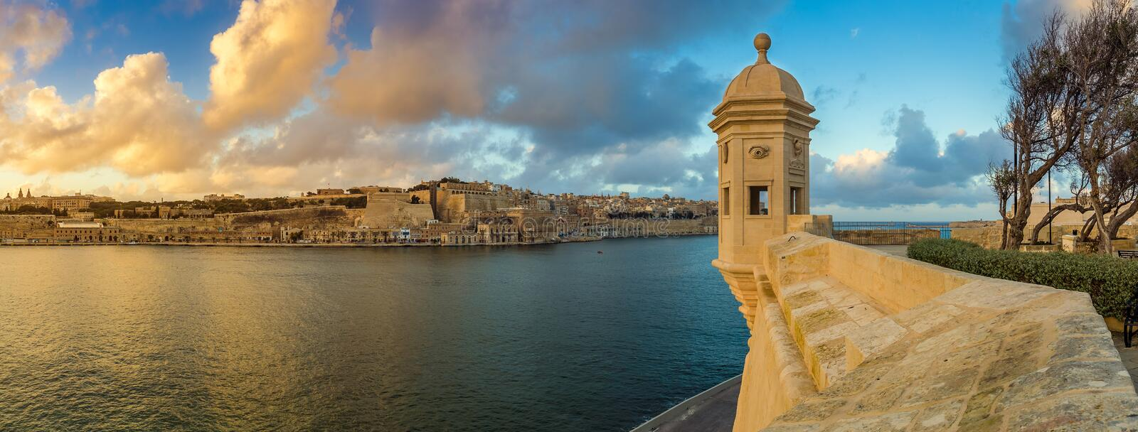 Senglea, Malta - Sunset and panoramic skyline view at the watch tower of Fort Saint Michael, Gardjola Gardens with beautiful sky. And clouds royalty free stock images