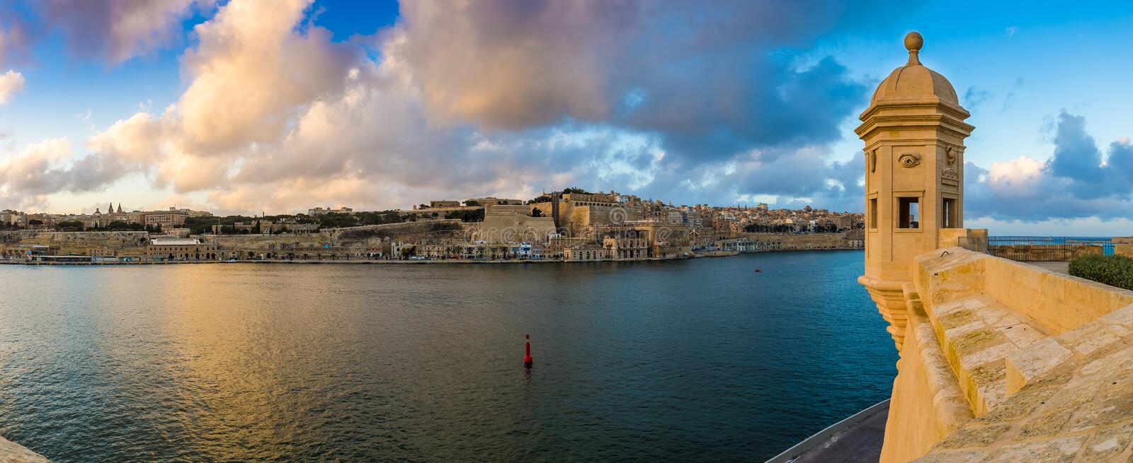 Senglea, Malta - Sunset and panoramic skyline view at the watch tower of Fort Saint Michael, Gardjola Gardens with beautiful sky. And clouds stock image