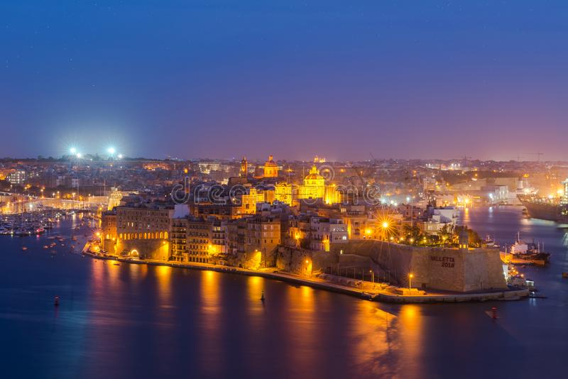 Senglea and Three Cities and Grand Harbor in Malta at night stock photography