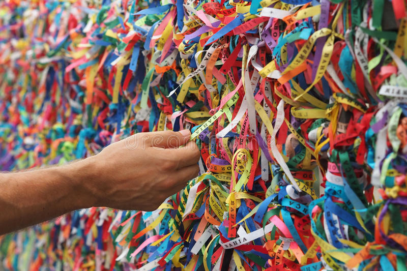 Senhor do Bonfin Ribbons in Pelourinho, Salvador, Bahia, Brazil. Tourist hand touching colorful Senhor do Bonfim ribbons in Pelourinho, Salvador, Bahia, Brazil stock photos