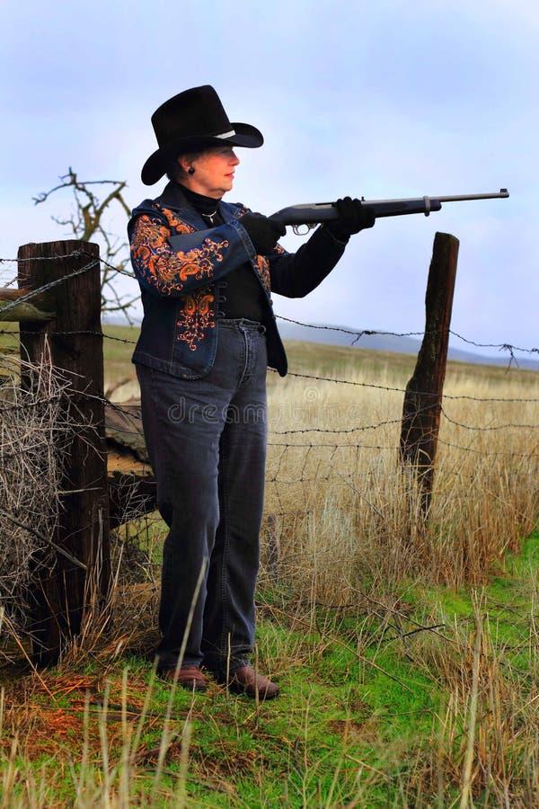 Senhora ativa Gunman fotos de stock royalty free