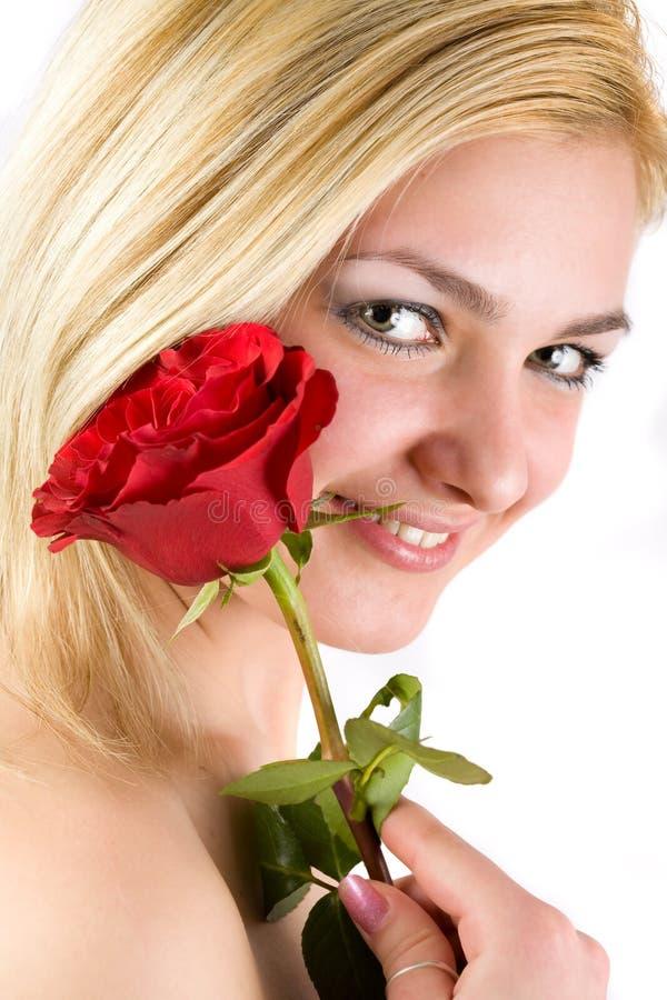 A senhora bonita com levantou-se fotos de stock royalty free