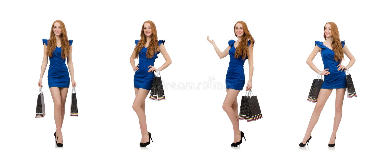 Senhora bonita na obscuridade - vestido azul isolado no branco imagem de stock