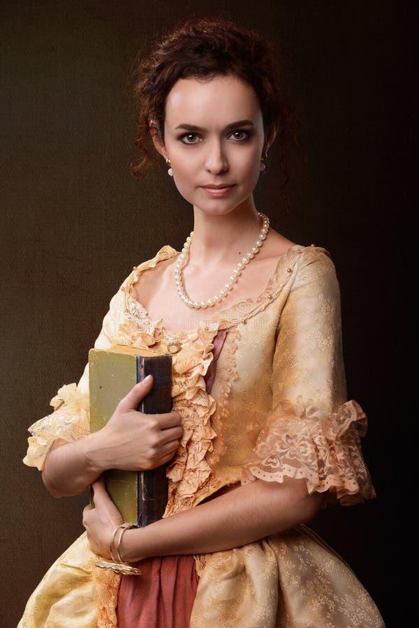 Senhora com livro fotografia de stock royalty free