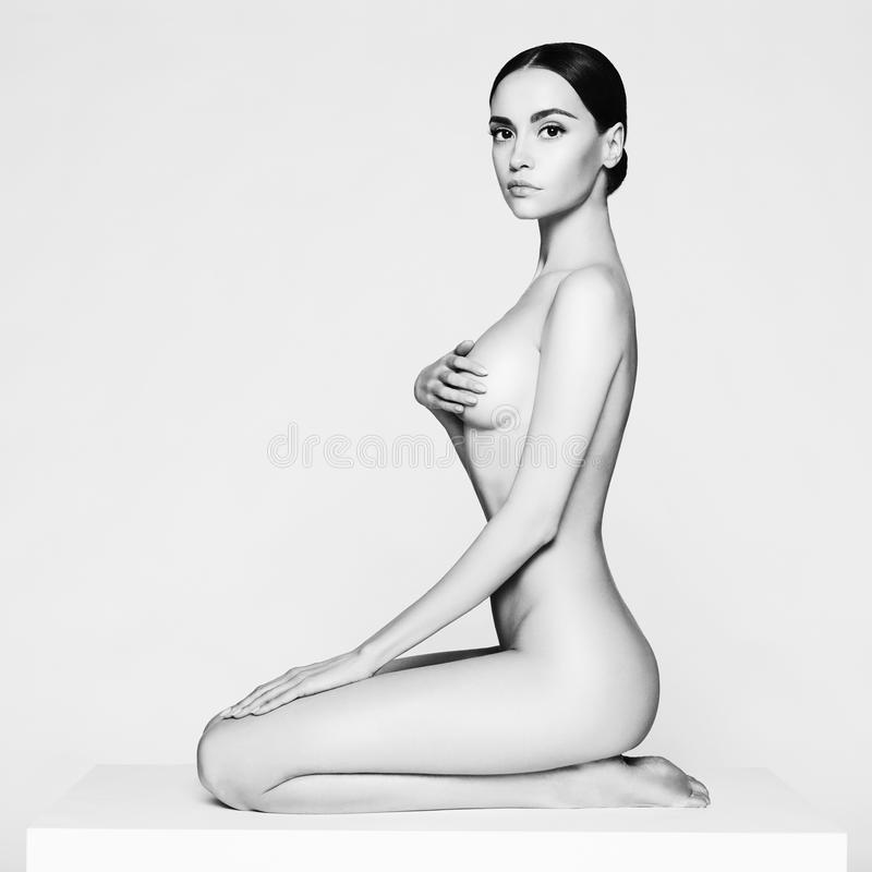 Senhora de assento elegante imagens de stock