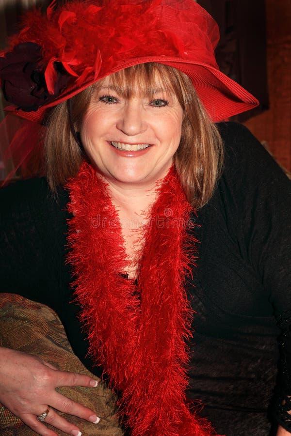 Senhora de sorriso de Red Hat fotos de stock