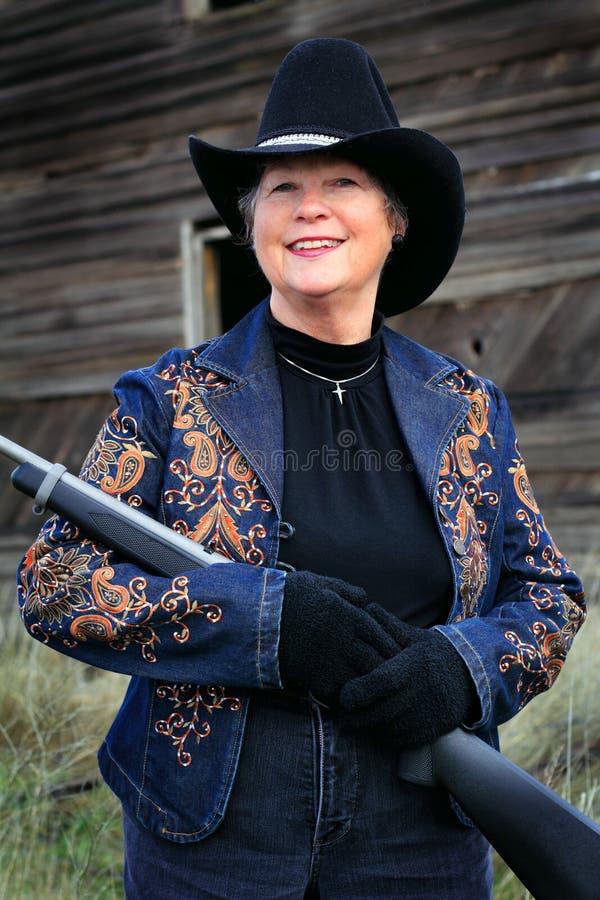 Senhora de sorriso Gunman fotografia de stock