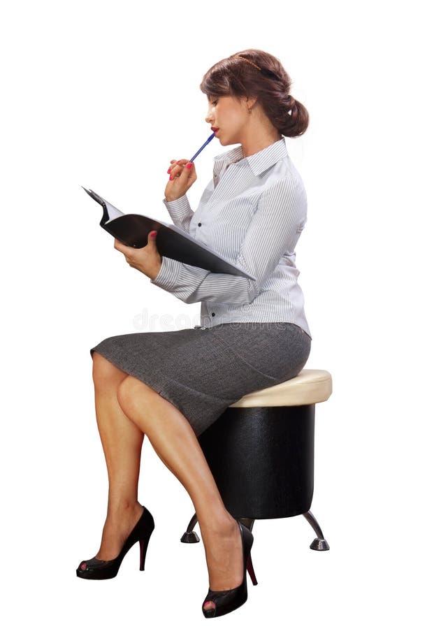Senhora do negócio com dobrador preto foto de stock