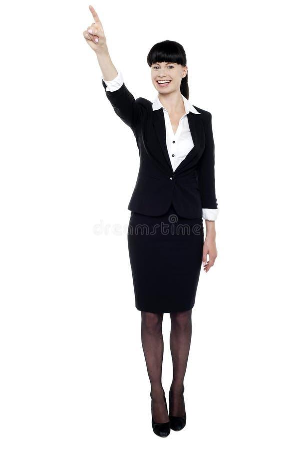 Senhora do negócio que aponta seu dedo para cima fotos de stock royalty free