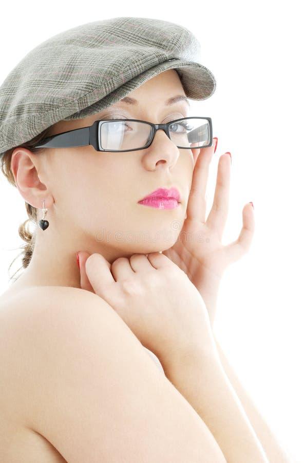 Senhora em topless em eyeglasses e no tampão plásticos pretos imagem de stock royalty free