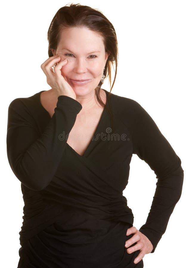 Senhora feliz com mão no mordente fotografia de stock royalty free