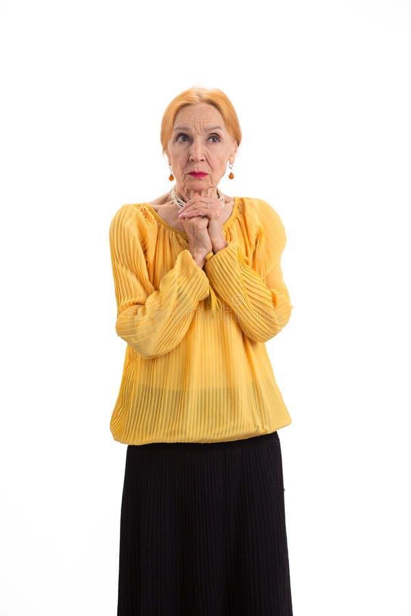 Senhora idosa preocupada imagem de stock