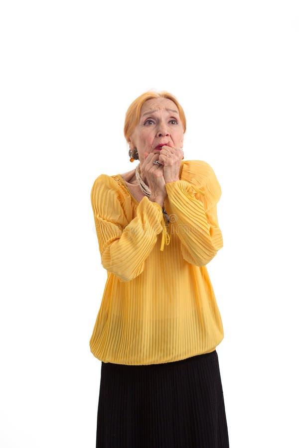Senhora idosa preocupada fotografia de stock royalty free