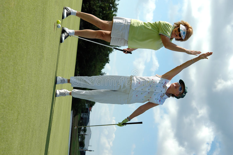 A senhora Jogador de golfe comemora