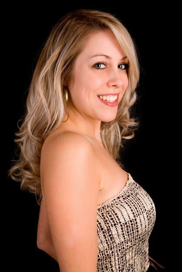 Senhora loura bonita em um vestido bege foto de stock