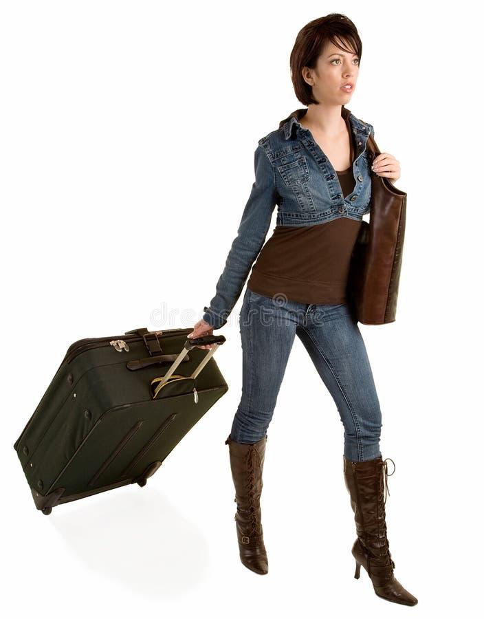 Senhora nova que puxa sua bagagem fotografia de stock