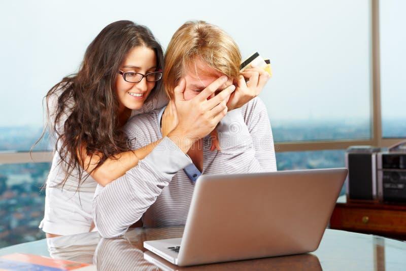 Senhora que tenta cheer acima seu esposo foto de stock royalty free