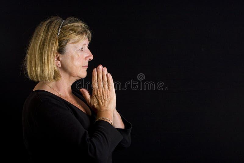 Senhora sênior - Pray fotos de stock