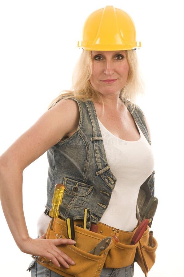 Senhora 'sexy' da construção do contratante com ferramentas imagem de stock