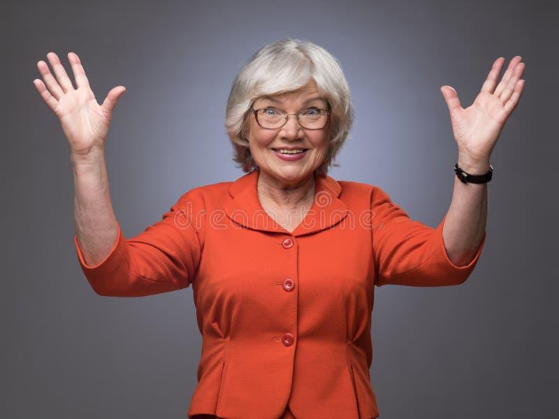 Senhora superior feliz com mãos acima imagens de stock royalty free