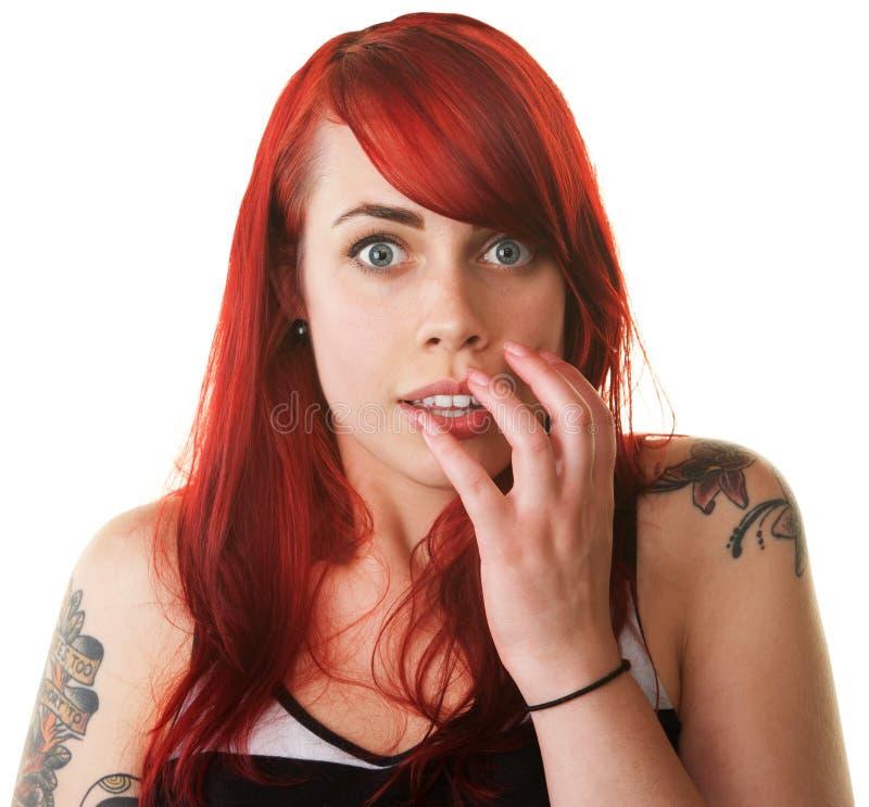 Senhora terrificada com tatuagens imagem de stock