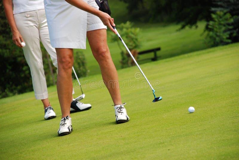 Senhoras do golfe fotografia de stock