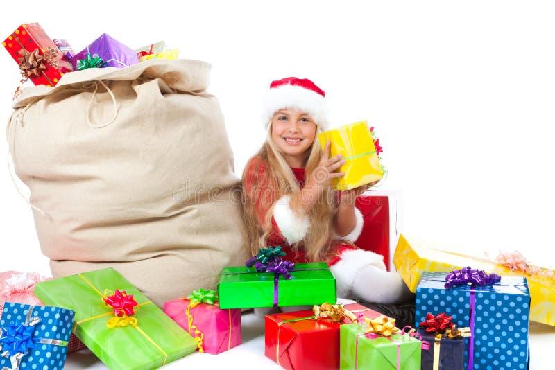 Senhorita Santa com saco do Natal e os presentes coloridos fotografia de stock royalty free