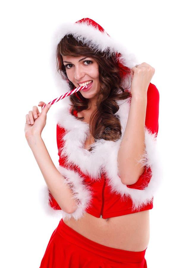 Senhorita 'sexy' Santa que come doces imagem de stock