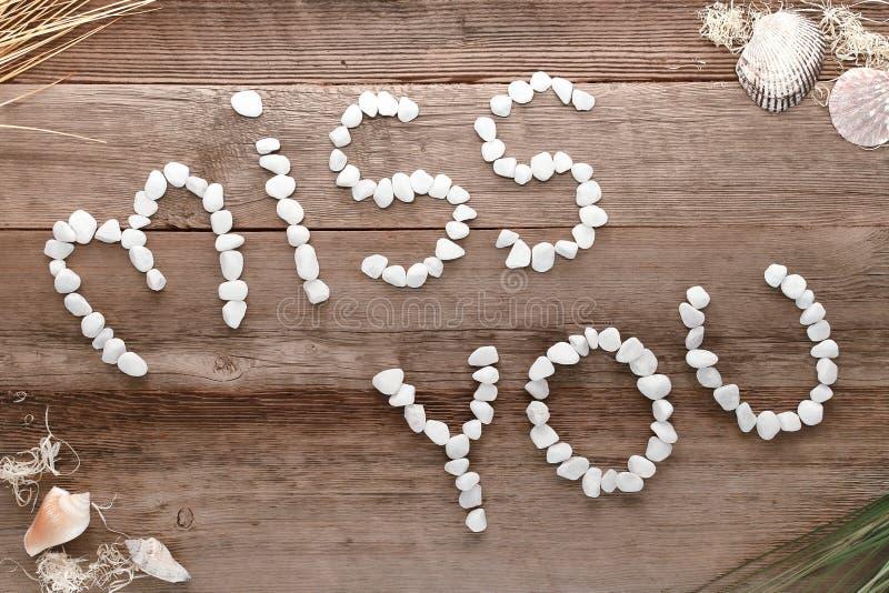 Senhorita Você Amor Palavra Written nos seixos na madeira velha imagem de stock