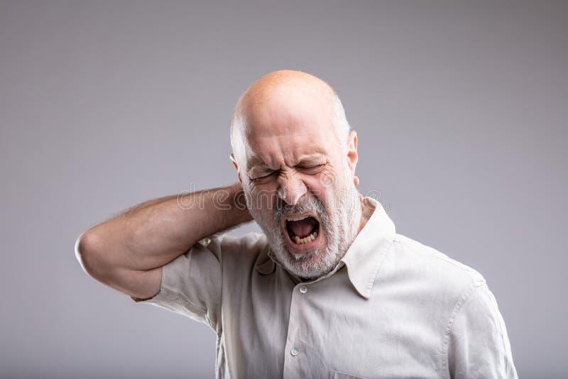 Mature man feeling bad for headache stock photos