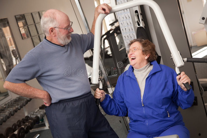 Senior Adult Couple in the Gym. Senior Adult Couple Working Out in the Gym royalty free stock images
