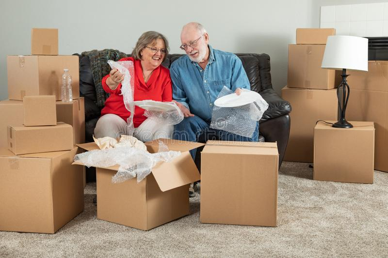 Senior Adult Couple Packing or Unpacking Moving Boxes stock images