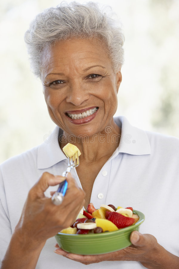 Senior Adult Eating A Fresh Fruit Salad Royalty Free Stock Photography