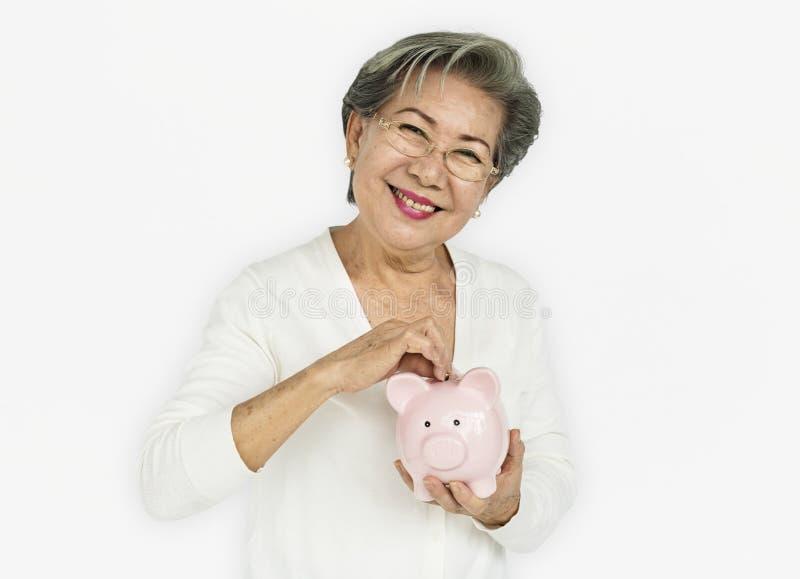 Senior Adult Hold Piggy Bank Concept stock images