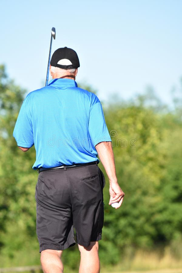 Senior Adult Male Athlete Outdoors With Golf Club Golfing stock photography
