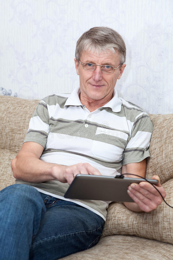 Download Senior Adult Man Working With New Tablet Computer Stock Image - Image: 27825425