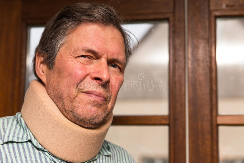 Senior adult with neck pain royalty free stock photography