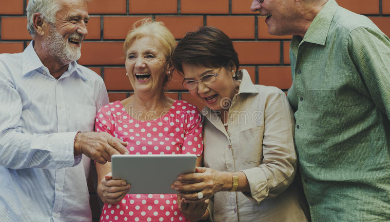 Senior Adult Use Tablet Technology royalty free stock images