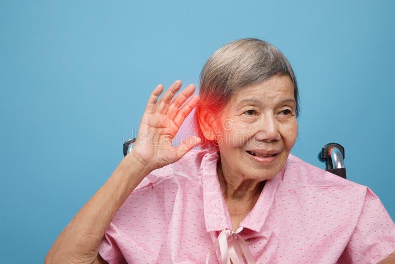 Senior adult woman hearing loss , Hard of hearing royalty free stock photos