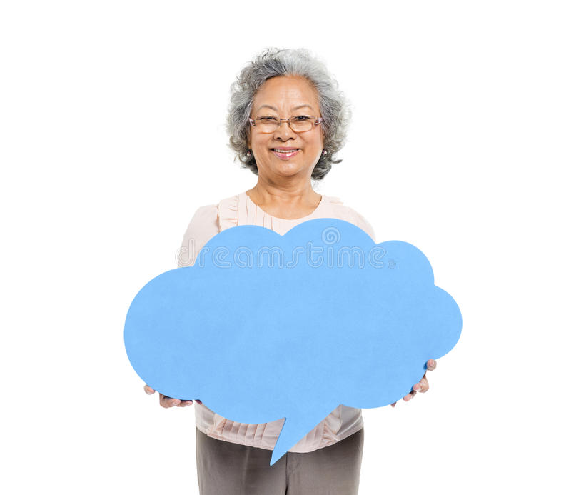 Senior Adult Woman Holding Speech Bubble royalty free stock photos